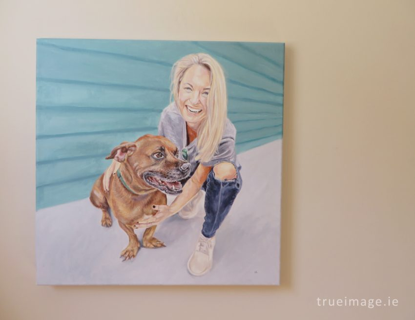 dog and owner portrait painting on a wall