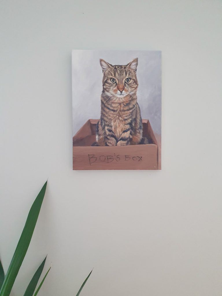 finished cat painting on the wall