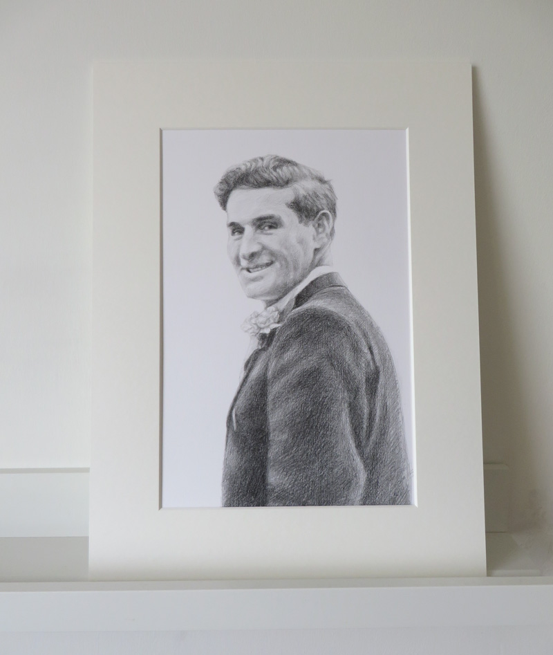 mounted portrait of a man smiling